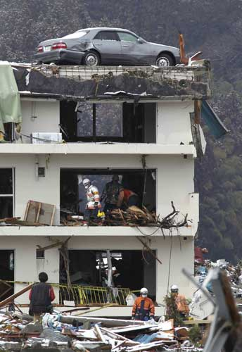 Firefighters search for missing people in Minamisanriku, northern Japan, Wednesday, March 16, 2011, after Friday&#39;s earthquake and tsunami. <span class=meta>( &#40;AP Photo&#47;The Yomiuri Shimbun, Hiroaki Ono&#41;)</span>